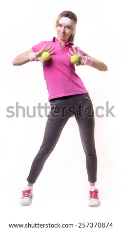 Pretty blonde female tennis player with two tennis balls isolated on a over white background - stock photo