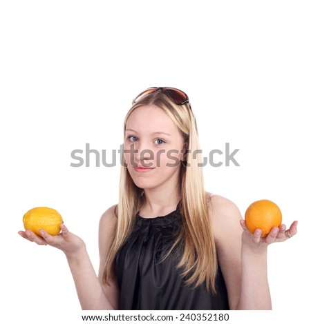 pretty blonde girl holding a lemon and orange in her hands