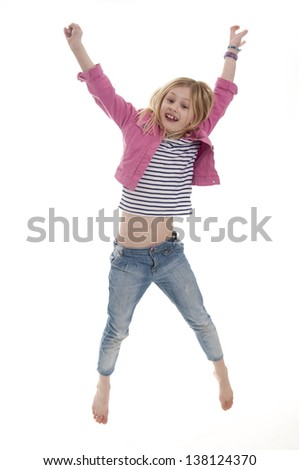 pretty blonde girl jumping in the air, isolated on white background