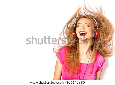 pretty blonde girl laughing while listening music on big red headphones isolated on white - copy space - stock photo