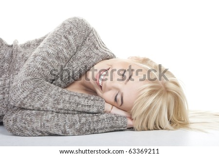 Pretty blonde girl lying as if sleeping - stock photo