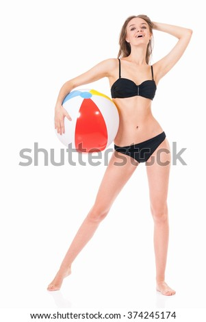 Pretty blonde girl posing in bikini with beach ball, isolated on white background