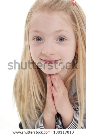 pretty blonde girl praying isolated on white background