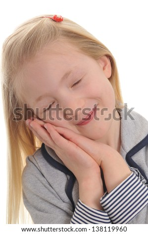 pretty blonde girl pretending to sleep isolated on white background