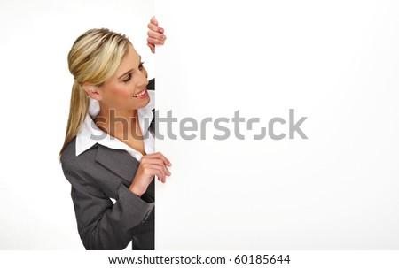 Pretty blonde girl with a blank presentation board - stock photo