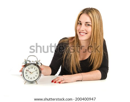 Pretty blonde girl with clock over white background
