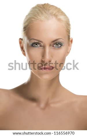 pretty blonde girl with naked shoulders, she is in front of the camera and looks in to the lens - stock photo