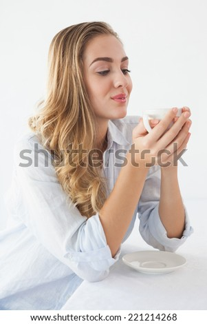 Pretty blonde having a coffee at the coffee shop - stock photo