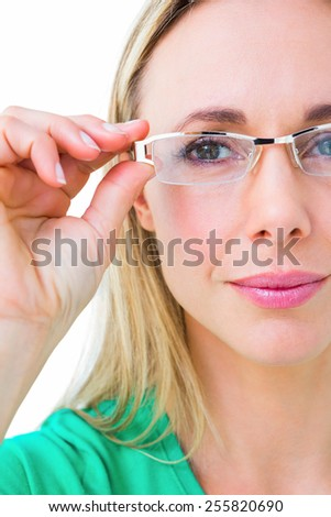 Pretty blonde holding her reading glasses on white background