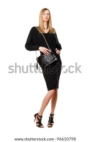 Pretty blonde in black in full length - stock photo