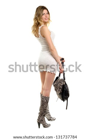 Pretty blonde in short white dress showing her sexy figure. Isolated - stock photo