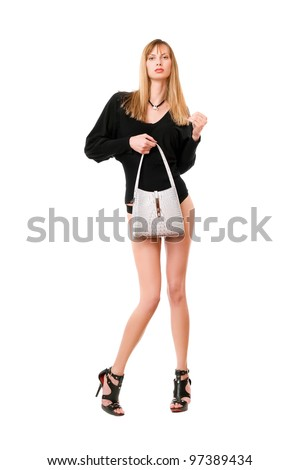 Pretty blonde lady with the white purse - stock photo