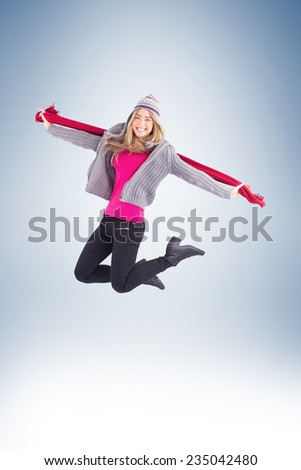 Pretty blonde posing in winter clothes on vignette background - stock photo