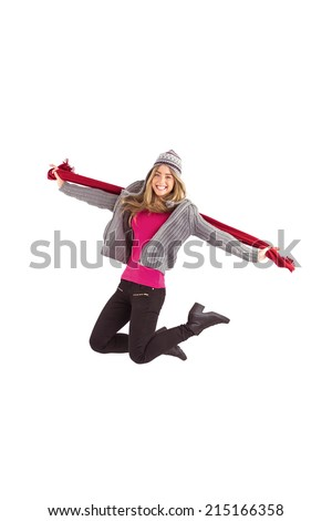 Pretty blonde posing in winter clothes on white background - stock photo