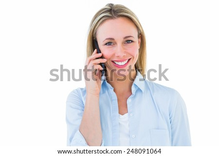 Pretty blonde smiling on the phone on white background - stock photo