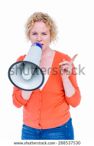 Pretty blonde speaking into megaphone on white background - stock photo