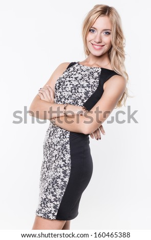 pretty blonde wearing flowered dress posing on white background - stock photo