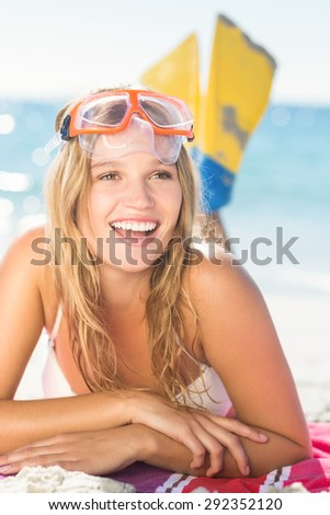 pretty blonde with snorkel and flippers at the beach - stock photo