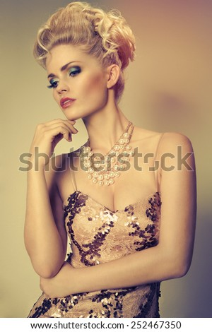 pretty blonde woman in a luxury dress - stock photo