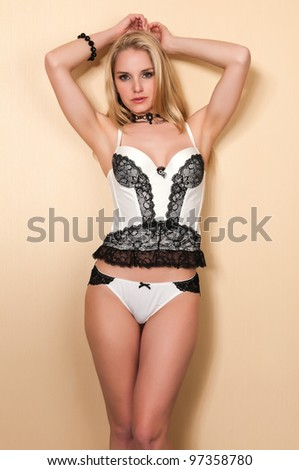 Pretty blonde woman in black and white lingerie - stock photo