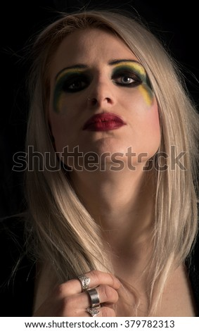 Pretty blonde woman with strong makeup