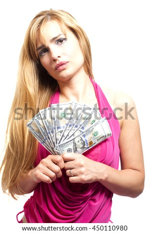 Pretty blonde woman with wad of dollars on white background