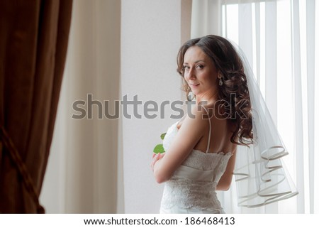 Pretty bride looking smiling on her wedding day