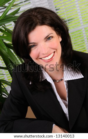 Pretty Brunette Business Woman Sat At Her Desk