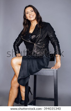 pretty brunette confident stylish real mature stock photo (royalty