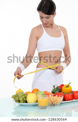 pretty brunette doing sport and eating healthily - stock photo