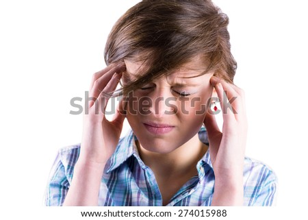 Pretty brunette getting a headache with hands on head on white background - stock photo