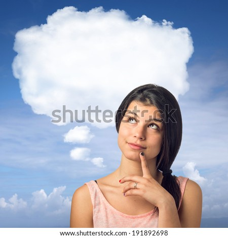 Pretty brunette girl in a thoughtful expression with a white cloud over her head - stock photo