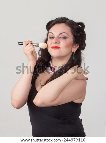Pretty brunette girl posing like Marilyn Monroe with red lips - stock photo