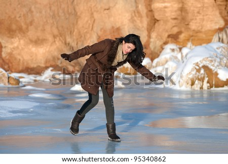 Pretty brunette girl slipping on ice