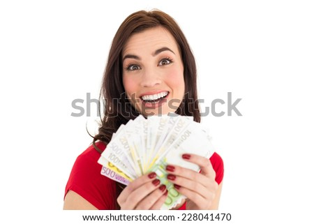 Pretty brunette holding her cash on white background