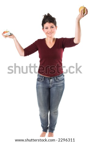 Pretty brunette holding up two apples, one surrounded by a measuring tape - stock photo