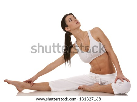pretty brunette in white active wear on white background - stock photo