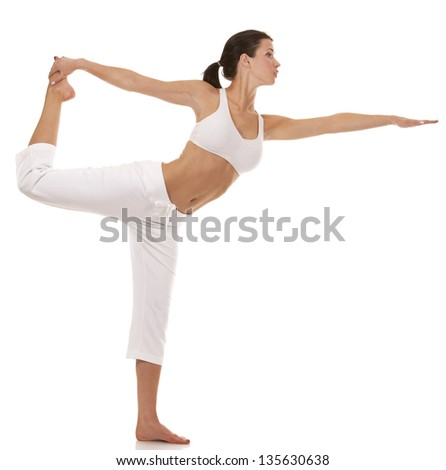 pretty brunette is exercising yoga on white background - stock photo