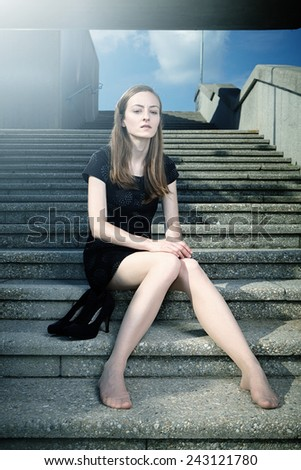 Pretty brunette lady posing on city building stairs for fashion and glamour photos