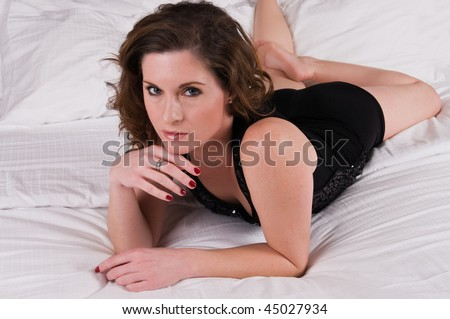 Pretty brunette lying in bed