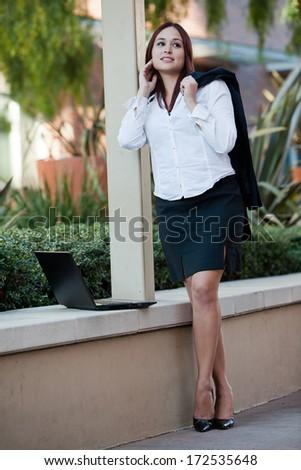 Pretty brunette native american businesswoman - stock photo
