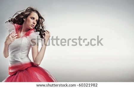 Pretty brunette posing, lots of copy space - stock photo