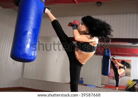 Pretty brunette ready to kick - stock photo