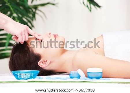 Pretty brunette relaxing with forehead massage
