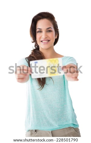 Pretty brunette showing a bill on white background