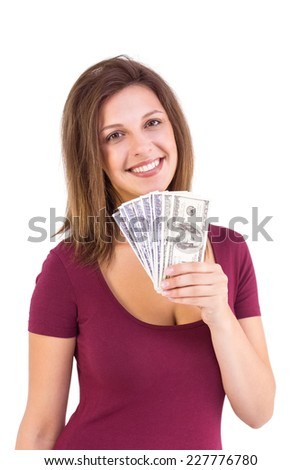 Pretty brunette showing wad of cash on white background - stock photo