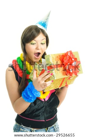 pretty brunette surprised girl opening her birthday present