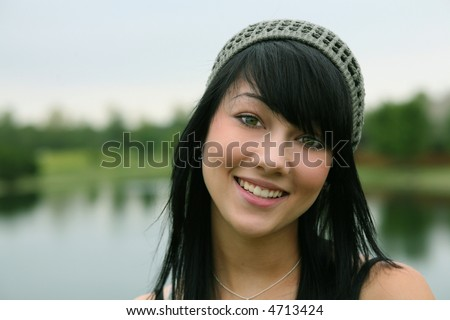 pretty brunette teen girl smiling closeup