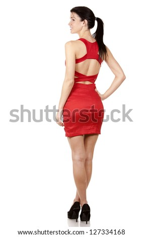 pretty brunette wearing red dress on white background - stock photo