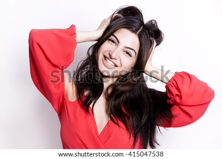 pretty brunette with long hair on white background wearing red - stock photo
